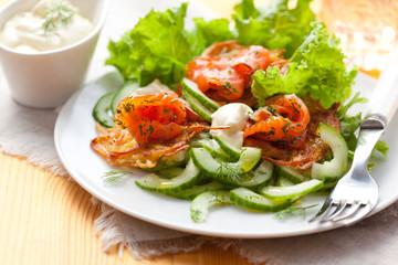 Potato rosti with smoked salmon and cucumber salad