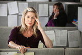 Woman in Office with Headache