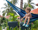 young boy relaxing in hammock