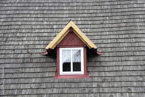 Old wooden roof with window.