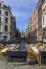 Outdoor terrace restaurant on the canal in Amsterdam.