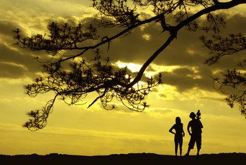 silhouette of photographer and woman. Sunrise