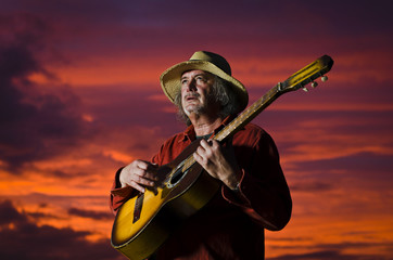 Sunset guitarist with surreal lighting