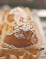 Powered with sugar, a beautiful apple tart covered with almonds