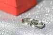 Wedding rings with a red gift