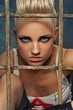 Punk girl behind bars