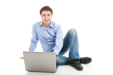 Young man sitting with laptop