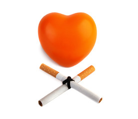 Orange heart  and two cigarettes isolated on white background.