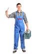 Repairman in overall holding a wrench and toolbox