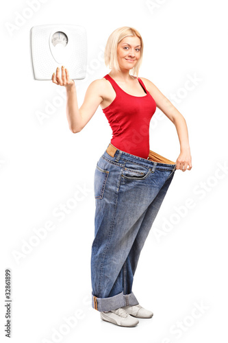 Weight loss female holding a weight scale
