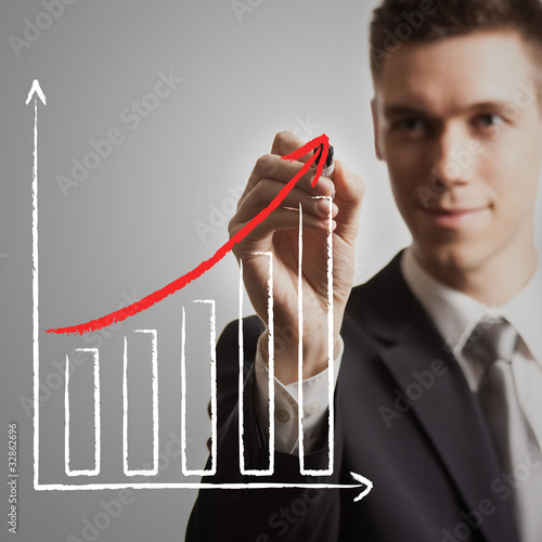 young businessman drawing chart