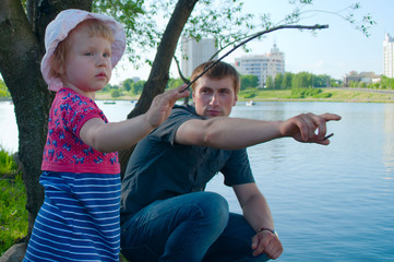 Dad with his daughetr on the river