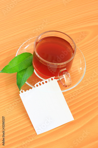 green tea and paper note