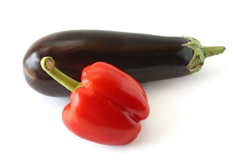 Eggplant and pepper on a white background