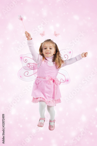 Little girl in fairy costume jump