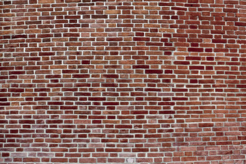 background of convex dark red brick wall
