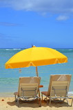 Vacation Image Of Bright Yellow Beach Umbrella And Loungers