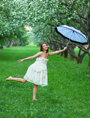 The young beautiful woman with white umbrella
