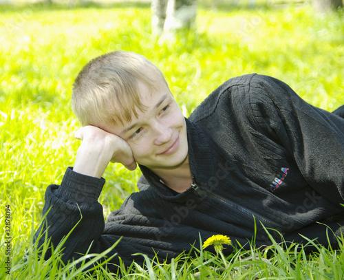 boy lying on green