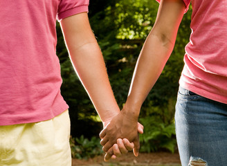 Teen roance - Hispanic boy and black girl holding hands