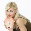 woman's portrait with a piggy bank