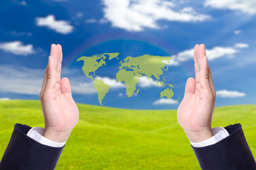 green world map in business man hand