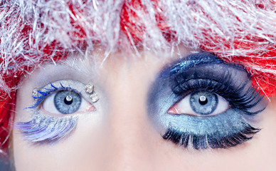 christmas concept eye makeup winter red silver macro