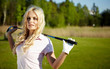 beauty blonde girl play golf