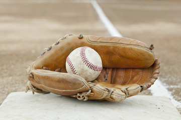 A baseball and baseball glove