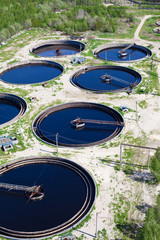 Biological water treatment plant with a round settlers