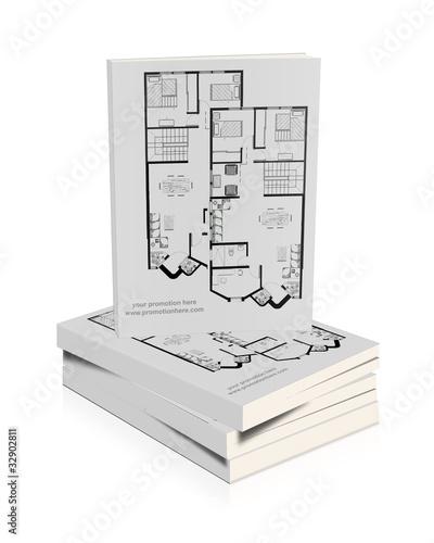 Libros apilados con planos de una vivienda