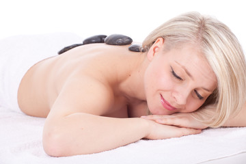 beautiful young woman in spa, stones massage