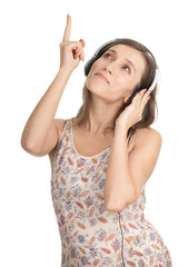 pointing young girl listening music from mp3 player