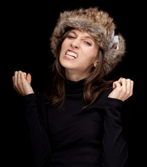 young woman in white winter hat , black background