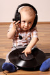 Cute baby dj with disc
