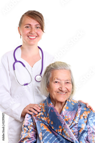 Nurse smiling with an elderly women isolated