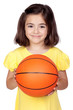 Brunette little girl with a basketball