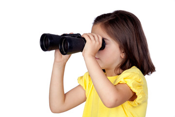 Brunette little girl looking through binoculars