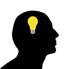 Silhouettes of male head and light bulb