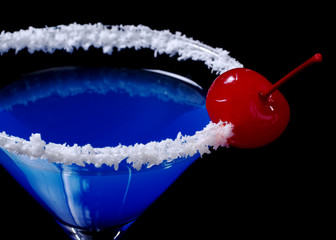Blue Curacao with coco flakes and maraschino cherry