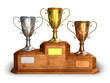 Gold, silver and bronze trophy cups on wooden pedestal