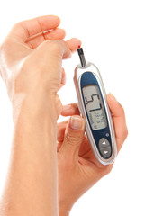 Diabetes patient measuring glucose level blood test