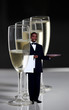 Waiter standing near champagne glasses