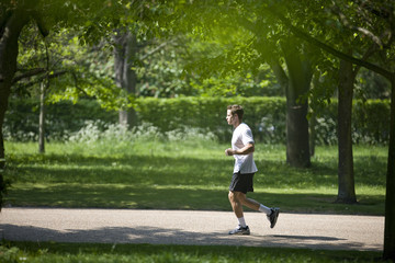 A young man jogging in the park