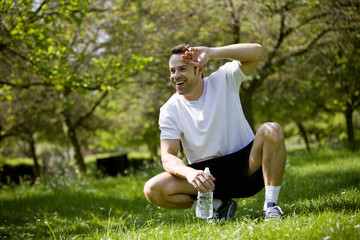 A young man taking a rest from running