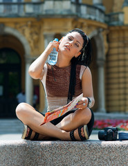 woman tourist cooling herself