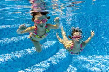 Two underwater kids in swimming pool