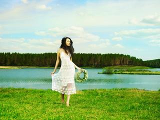 Beautiful girl wearing a wreath of wildflowers