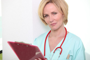 Nurse taking notes