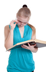 A young girl in glasses with a book